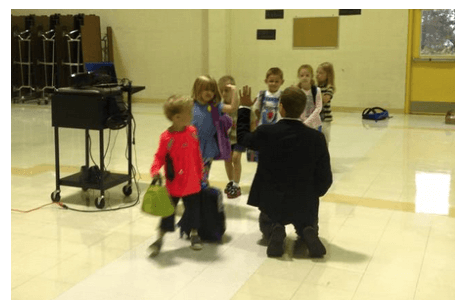 New Morey Montessori Academy Principal Eric Johnson gives high-fives to the Kindergarteners on the first day of school.