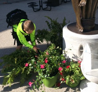 Image Of A Student From Charter School Organization Playing With the Plants In Detroit, MI - Choice Schools Associates