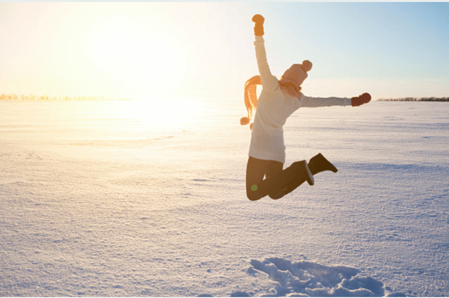 A person jumping in the snow