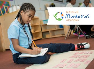 A student studying in a promotion for Macomb Montessori Academy