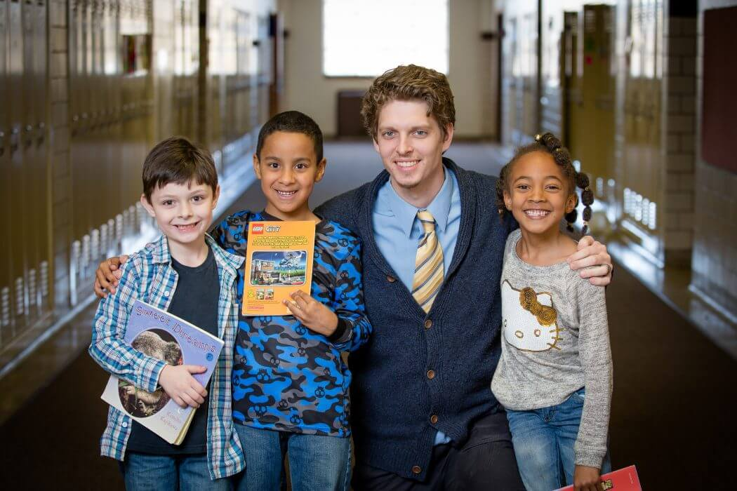 Three-Oaks-students-with-assistant-principal-bosker-smiling