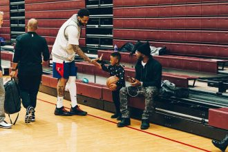 NBA 76ers basketball star Levi supported​​​ Benton Harbor Charter School Academy student facing hard times (photo credit by nba.com)