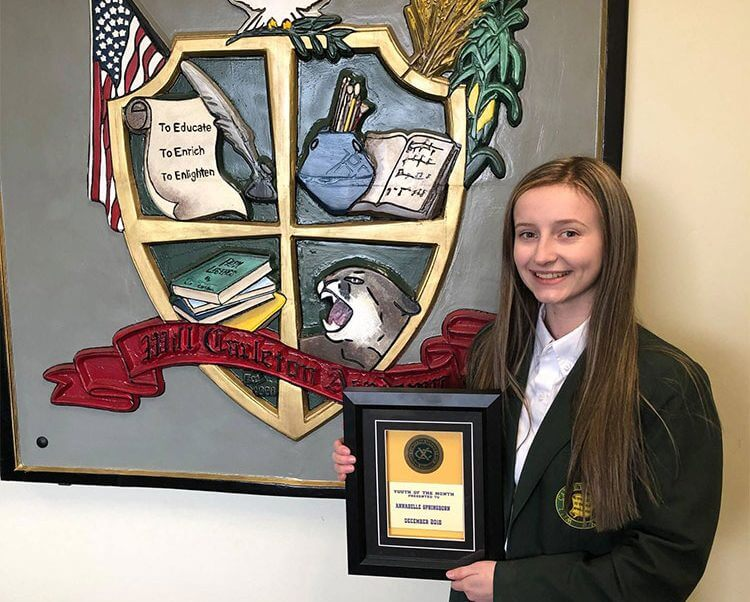 Will Carleton Academy student Annabelle accepting award for Exchange Club Youth of the Month