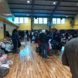 Gym filled with Dove Academy students and teachers during Operation Warm and Comfort