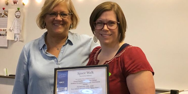 Terry Larkin presenting Betsy Bell with certificate